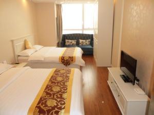 Dalian Xinshijia Ganghui Service Apartment, Апартаменты  Далянь - big - 12