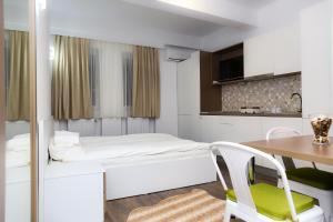 Studio, Apartmanok  Bukarest - big - 19