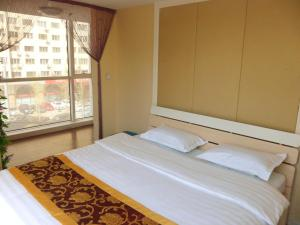 Dalian Xinshijia Ganghui Service Apartment, Апартаменты  Далянь - big - 34