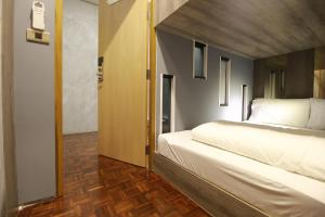 Private Double Bed Capsule Room with Shared Bathroom