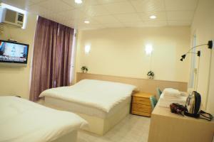 Sun Moon Star Hostel, Проживание в семье  Budai - big - 27
