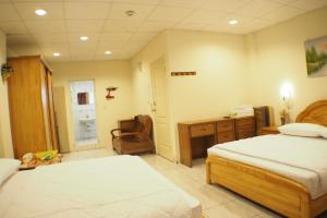 Sun Moon Star Hostel, Проживание в семье  Budai - big - 29