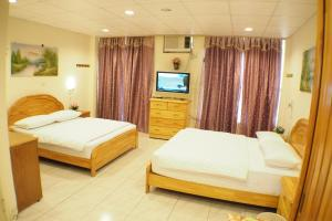 Sun Moon Star Hostel, Проживание в семье  Budai - big - 30