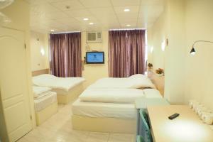 Sun Moon Star Hostel, Проживание в семье  Budai - big - 39