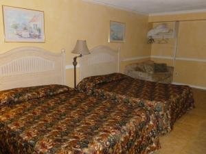 Queen Room with Two Queen Beds with Sofa Bed