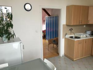 Bed in 8-Bed Dormitory Room with private bathroom and kitchen