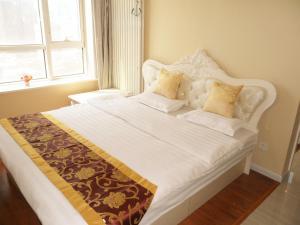 Dalian Xinshijia Ganghui Service Apartment, Апартаменты  Далянь - big - 14