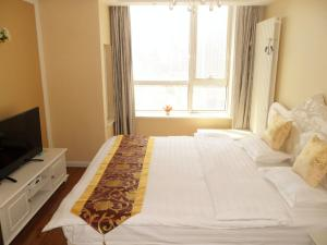 Dalian Xinshijia Ganghui Service Apartment, Апартаменты  Далянь - big - 17