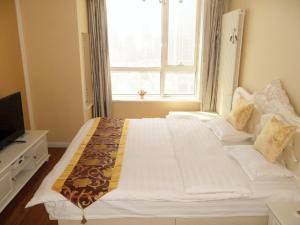 Dalian Xinshijia Ganghui Service Apartment, Апартаменты  Далянь - big - 18