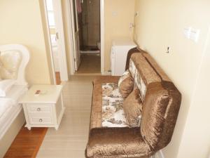 Dalian Xinshijia Ganghui Service Apartment, Апартаменты  Далянь - big - 19