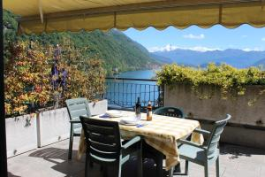 Sunny terrace and lake view Argegno