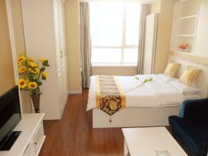 Dalian Xinshijia Ganghui Service Apartment, Апартаменты  Далянь - big - 23