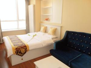 Dalian Xinshijia Ganghui Service Apartment, Апартаменты  Далянь - big - 25