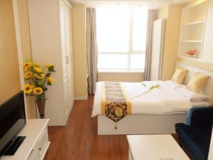 Dalian Xinshijia Ganghui Service Apartment, Апартаменты  Далянь - big - 26