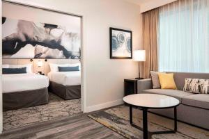 Deluxe Queen Suite with Two Queen Beds and Sofa Bed - City View