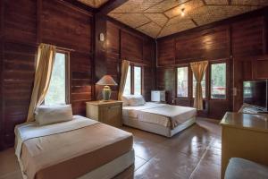 G-Land Joyo's Surf Camp, Гостевые дома  Баньюванги - big - 14
