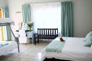Dreibettzimmer mit Badewanne