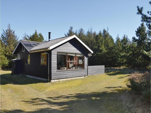 Four-Bedroom Holiday home Saltum with a Fireplace 03
