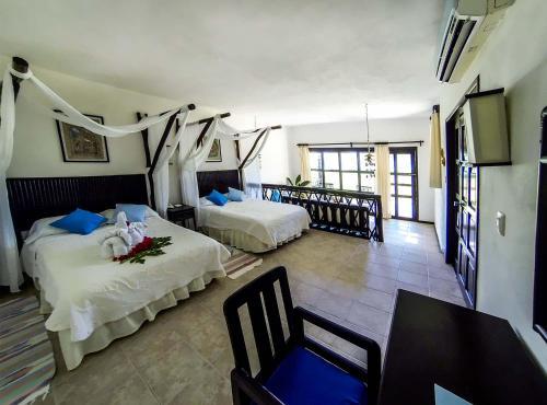 Hotel Cabañas Los Lirios Tulum Photo