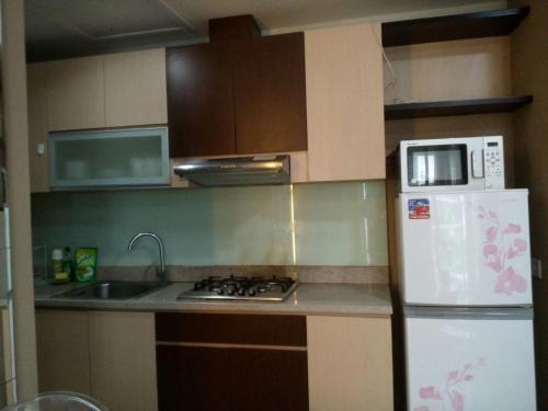 A Hotel Com Malibu By Aston Balikpapan Apartment Stalkudo
