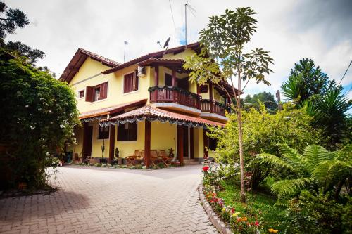 Pousada Unser Haus Photo
