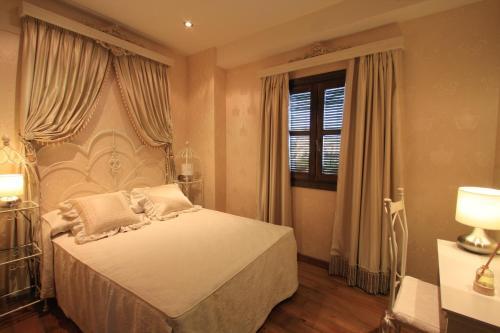 Suite Apartamento de 2 dormitorios con acceso gratuito al spa Casa Baños de la Villa 13