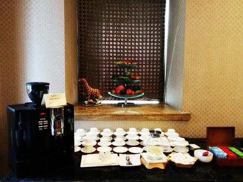 Wealthy All Suite Hotel Suzhou photo 52