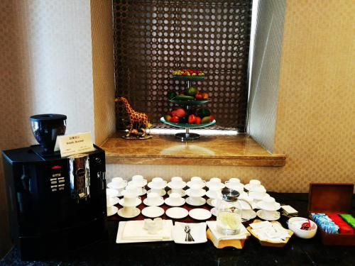 Wealthy All Suite Hotel Suzhou photo 53