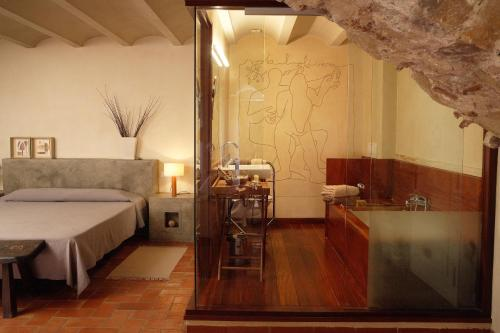 Suite Hotel la Plaça Madremanya 28