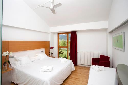 Habitación Doble con cama supletoria (3 adultos) Tierra de Biescas 16