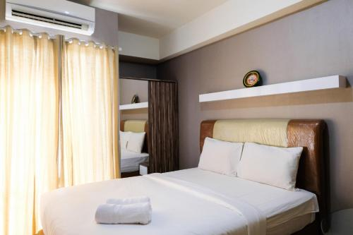 Homey Studio Room at Serpong Greenview Apartment By Travelio