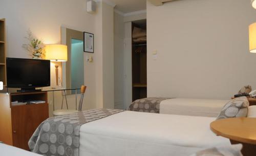 Parra Hotel & Suites Photo