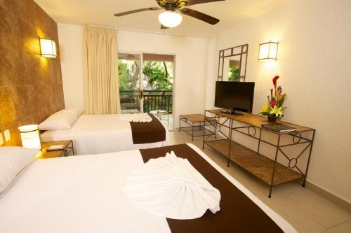 Tukan Hotel & Beach Club Photo