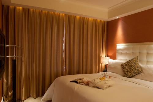 Wealthy All Suite Hotel Suzhou photo 44