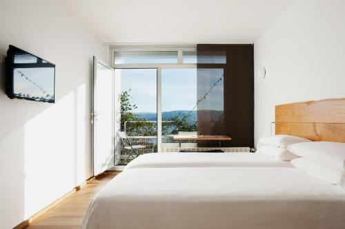 Double Room with Balcony and Sea View Hotel A Miranda 1