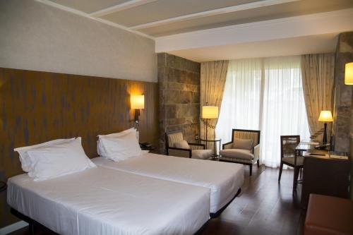 Habitación Doble Estándar - 2 camas Hotel Nuevo Portil Golf 10