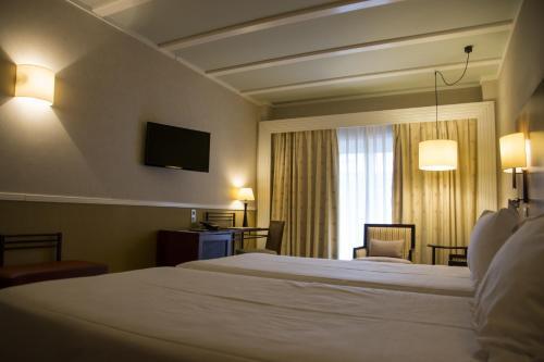 Habitación Doble Estándar - 2 camas  Hotel Nuevo Portil Golf 12