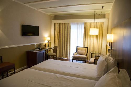 Habitación Doble Estándar - 2 camas  Hotel Nuevo Portil Golf 13
