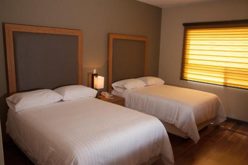 MBM Red Sun Hotel Photo