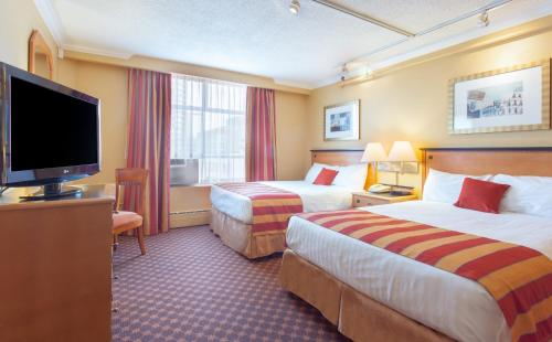 Howard Johnson Hotel By Wyndham Vancouver Downtown - Vancouver, BC V6Z1L8