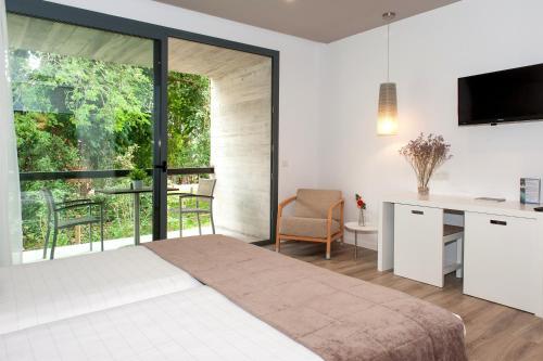 Habitación Doble Superior con balcón URH - Hotel Molí del Mig 4