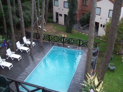 Apart Hotel Las Hadas Carilo Photo