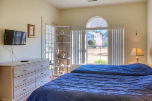 Magnolia Place 102-4765 Condo Photo