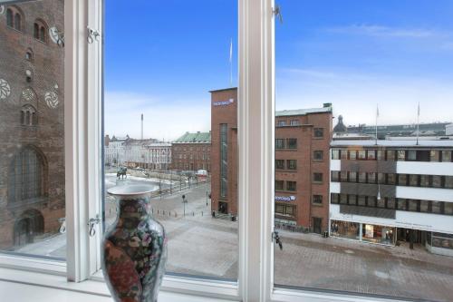 Store Torv 4, 8000 Arhus, Denmark.