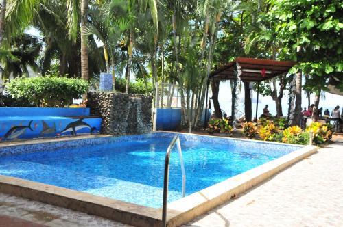 Hotel el velero playa hermosa desde 91 rumbo for El jardin prohibido restaurante