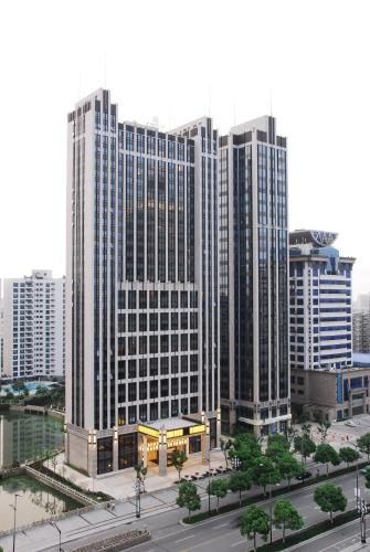 Wealthy All Suite Hotel Suzhou photo 2