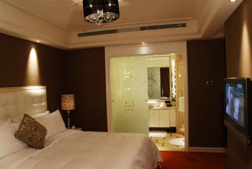 Wealthy All Suite Hotel Suzhou photo 10
