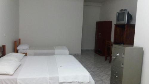 Foto de Hotel Tudo de Bom