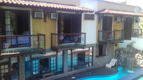 Casa Encantada Hotel & Suítes Photo
