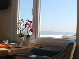 Фотографія готелю: Qinn Apartments
